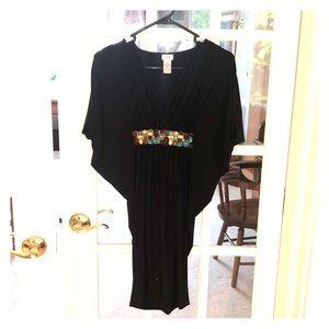 Black cache evening dress.
